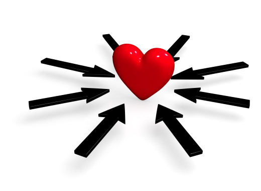 A bright, red heart is surrounded by several black arrows all pointing towards it. Isolated on white.